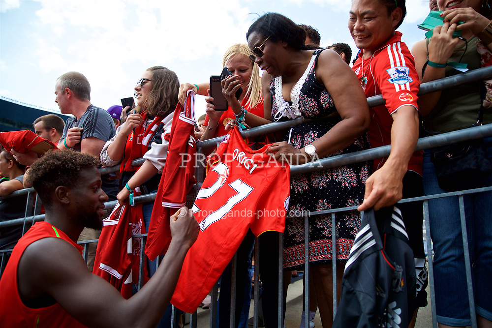 ANN ARBOR, USA - Friday, July 27, 2018: Liverpool's Divock Origi signs autographs for supporters after a training session ahead of the preseason International Champions Cup match between Manchester United FC and Liverpool FC at the Michigan Stadium. (Pic by David Rawcliffe/Propaganda)