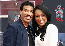 Lionel Richie and Lisa Parigi at Lionel Richie Hand And Footprint Ceremony held at the TCL Chinese Theatre in Hollywood, USA on March 7, 2018. (Photo by Lumeimages/Sipa USA)