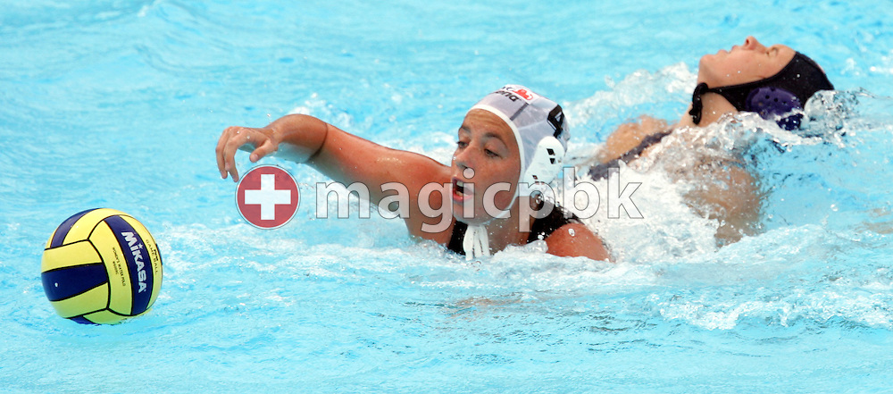 Hungary's Dora Kisteleki (L) and USA's Erika Figge (R)  fight for the ball during their preliminary round women's water polo match at the FINA World Championships in Montreal, Quebec Tuesday 19 July, 2005.  (Photo by Patrick B. Kraemer / MAGICPBK)