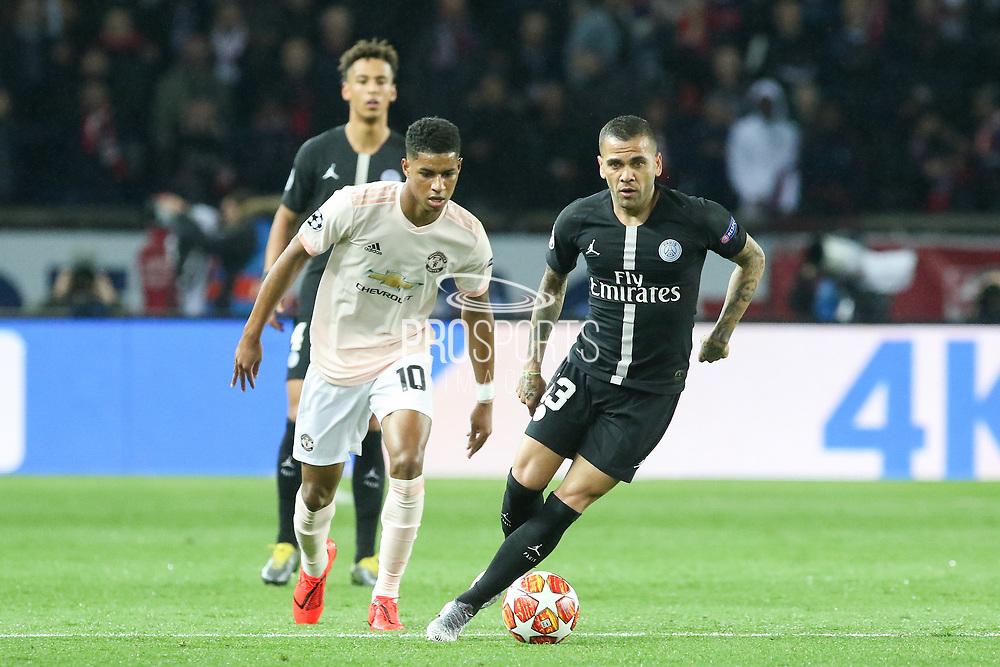 Dani Alves of Paris Saint-Germain battles with Manchester United Forward Marcus Rashford during the Champions League Round of 16 2nd leg match between Paris Saint-Germain and Manchester United at Parc des Princes, Paris, France on 6 March 2019.
