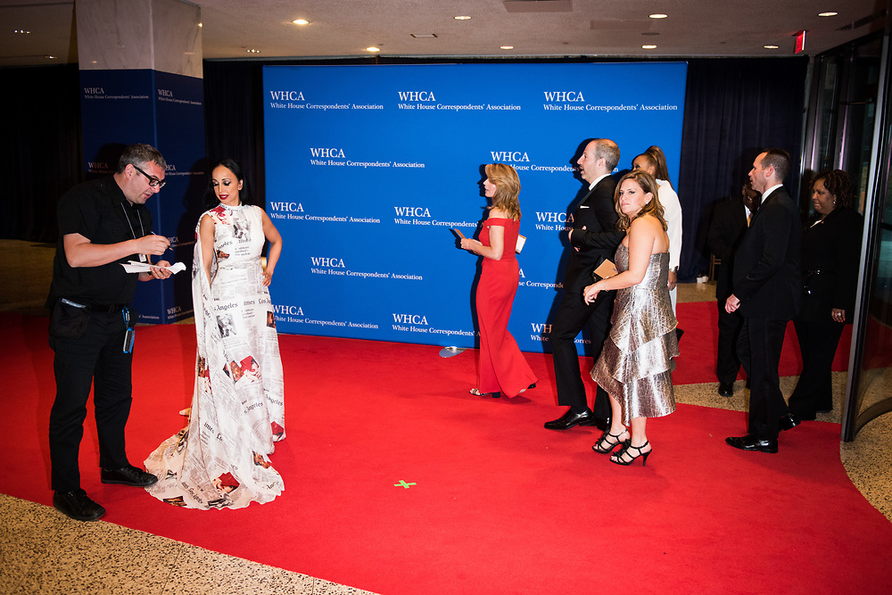 Dr. Nina Radcliff, on-air doctor for FOX News, gives her name to a photographer as people arrive on the red carpet at the White House Correspondents' Dinner in Washington, D.C. on April 29, 2017. CREDIT: Mark Kauzlarich for CNN