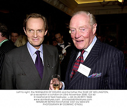 Left to right, the MARQUESS OF DOURO and his father the DUKE OF WELLINGTON, at a reception in London on 23rd November 2000.OJI 63