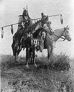 Village criers on horseback, Bird On the Ground and Forked Iron, Crow Indians, Montana,1908  Photograph by Edward Curtis (1868-1952).