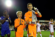 AFC Wimbledon goalkeeper George Long (1) with AFC Wimbledon mascot givign thumbs up during the EFL Sky Bet League 1 match between AFC Wimbledon and Milton Keynes Dons at the Cherry Red Records Stadium, Kingston, England on 22 September 2017. Photo by Matthew Redman.