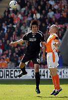 Photo: Paul Thomas.<br /> Blackpool v Swansea City. Coca Cola League 1. 15/04/2006.<br /> <br /> Swansea's Rory Fallon wins the ball over Blackpool's Rob Edwards.