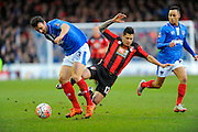 Portsmouth's Enda Stevens steals the ball off AFC Bournemouth midfielder Juan Manuel Iturbe during the The FA Cup fourth round match between Portsmouth and Bournemouth at Fratton Park, Portsmouth, England on 30 January 2016. Photo by Graham Hunt.
