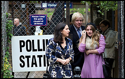 London Mayor Boris Johnson with his wife Marina and his daughter Lara Johnson as she votes for the first time,  in North London, on  The Mayoral Election Day, Thursday May 3, 2012. Photo By Andrew Parsons/i-Images