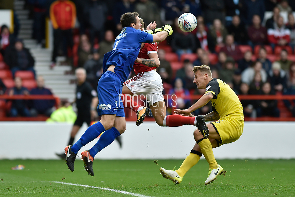 Burton Albion goalkeeper Stephen Bywater (1) beats Nottingham Forest striker Jason Cummings (35) to the ball during the EFL Sky Bet Championship match between Nottingham Forest and Burton Albion at the City Ground, Nottingham, England on 21 October 2017. Photo by Richard Holmes.