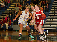 Gilford's Madison Harris tries to slow down Laconia's Cheyenne Zappala during the girls finals at the 41st annual Holiday Basketball Tournament at Gilford High School Tuesday evening.  (Karen Bobotas/for the Laconia Daily Sun)
