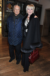 MICHAEL WINNER and his wife GERALDINE at a private view to celebrate the opening of the Royal Academy's exhibition of work by David Hockney held at The Royal Academy, Burlington House, Piccadilly, London on 17th January 2012.