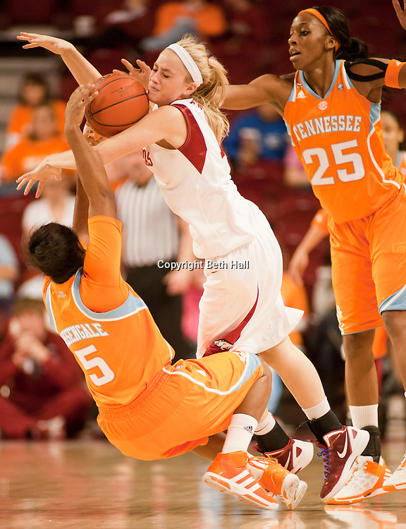 Jan 8, 2012; Fayetteville, AR, USA; Tennessee Lady Volunteers forward Glory Johnson (25) and guard Ariel Massengale (5) knock the ball away from Arkansas Razorbacks guard Calli Berna (11) during the first half of a game at Bud Walton Arena. Mandatory Credit: Beth Hall-US PRESSWIRE
