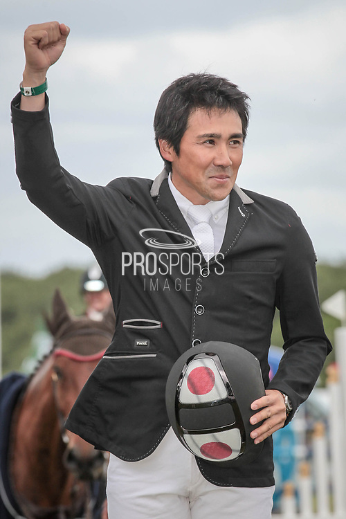 Overall Equitrek CCI*** winner CALLE 44 ridden by Yoshiaki Oiwa (JPN) punches the air having won the competition after the final show jumping round on day four of Bramham International Horse Trials 2017 at  at Bramham Park, Bramham, United Kingdom on 11 June 2017. Photo by Mark P Doherty.