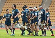 Highlanders player JOSH HOHNECK (c) is congratulated with a tap on the head from ASH DIXON (immediate right) following a try during the Natixis Cup rugby match between French team Racing 92 and New Zealand team Otago Highlanders at Sui San Wan Stadium in Hong Kong.