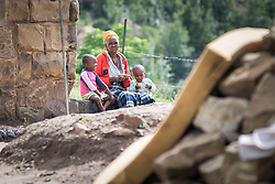 3 March 2017, Thaba Bosiu, Lesotho: In the village of Thaba Bosiu, Lesotho. Thaba Bosiu is a sandstone plateau some 24 kilometers east of Lesotho's capital, Maseru. The name means Night Mountain, and surrounding the plateau is a small village and open plains. Thaba Bosiu was once the capital of Lesotho, and the mountain was the stronghold of the Basotho king when the kingdom of Lesotho was formed. Consent obtained.