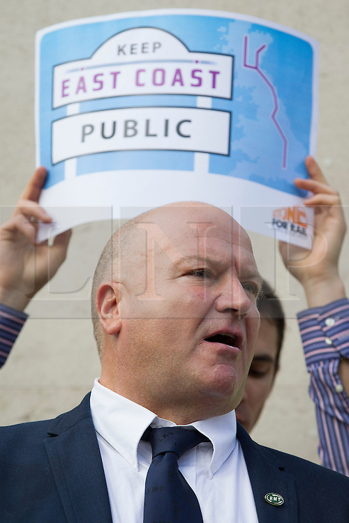 © Licensed to London News Pictures. 18/10/2013. London, UK. General Secretary of the National Union of Rail, Maritime and Transport Workers, Bob Crow is seen talking at a protest against the re-privatisation of the United Kingdom's East Coast Line in London today (18/10/2013) ahead of handing in a petition consisting of 23,000 commuter's signatures to the transport ministry. The East Coast Line, which runs from London to Scotland, is currently the only publicly owned train line after passing to the government from previous operator National Express who encountered financial difficulties. Photo credit: Matt Cetti-Roberts/LNP