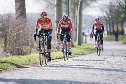 Megan Guarnier of the Boels-Dolmans Cycling Team rides one of the cobbled section of the 2015 Omloop Het Niewsblaad Dames race.