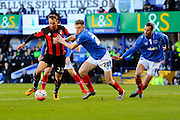 AFC Bournemouth forward Glenn Murray and Portsmouth's Matthew Clarke during the The FA Cup fourth round match between Portsmouth and Bournemouth at Fratton Park, Portsmouth, England on 30 January 2016. Photo by Graham Hunt.