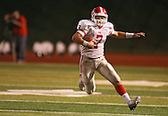 Washington's Charles Blades (7) looks to cut back on a run during the second quarter of the game between Cedar Rapids Washington and Linn-Mar at Linn-Mar Stadium in Marion on Friday, September 14, 2012.