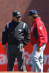 April 8, 2011; San Francisco, CA, USA;  St. Louis Cardinals manager Tony La Russa (right) argues a call with MLB umpire Phil Cuzzi (10)during the second inning against the San Francisco Giants at AT&T Park.  San Francisco defeated St. Louis 5-4 in 12 innings.