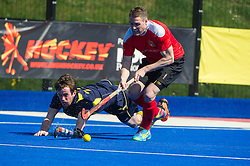 Holcombe's Gareth Andrews escapes the diving tackle of Ben Carless. Holcombe v Team Bath Buccaneers - Now: Pensions Finals Weekend, Lee Valley Hockey & Tennis Centre, London, UK on 12 April 2015. Photo: Simon Parker