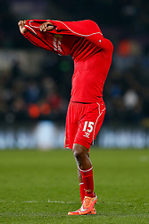 Daniel Sturridge of Liverpool removes his shirt for a fan after Liverpool win the match 0-1 - Photo mandatory by-line: Rogan Thomson/JMP - 07966 386802 - 16/03/2015 - SPORT - FOOTBALL - Swansea, Wales — Liberty Stadium - Swansea City v Liverpool - Barclays Premier League.