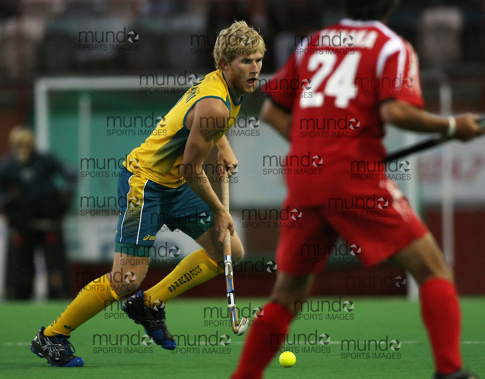 (Canberra, Australia---29 March 2012) Mathew Butturini of the Australia Kookaburra national field hockey team playing in the first of a three game test series against Japan. 2012 Copyright Photograph Sean Burges / Mundo Sport Images.