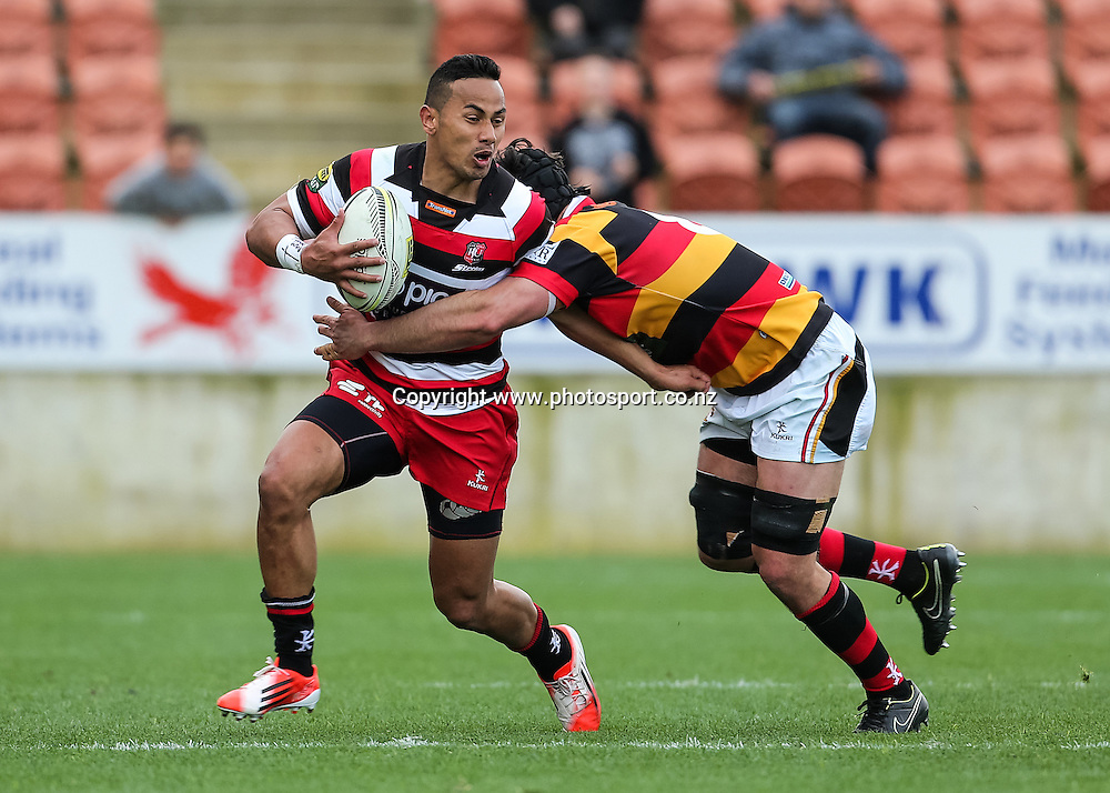 Counties Maunkau's Toni Pulu looks to fend off Waikato's Adam Burn during the ITM Cup rugby match - Waikato v Counties Manukau at Waikato Stadium, Hamilton on Sunday 14 September 2014.  Photo: Bruce Lim / www.photosport.co.nz