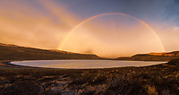 NATIONAL PARK TORRES DEL PAINE, CHILE - CIRCA FEBRUARY 2019:  Panoramic view of a rainbow at sunrise in Torres del Paine National Park, Chile.