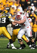 18 OCTOBER 2008: Wisconsin offensive lineman Andy Kemp (75) blocks Iowa linebacker Pat Angerer (43) in the first half of an NCAA college football game against Wisconsin, at Kinnick Stadium in Iowa City, Iowa on Saturday Oct. 18, 2008. Iowa won 38-16.