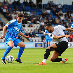 TELFORD COPYRIGHT MIKE SHERIDAN Brendon Daniels of Telford has his shot blocked by Jamie Morgan during the National League North fixture between AFC Telford United and Chester FC at the New Bucks Head on Saturday, September 14, 2019<br /> <br /> Picture credit: Mike Sheridan<br /> <br /> MS201920-018