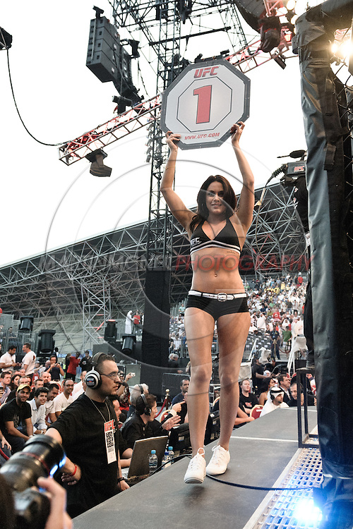 """ABU DHABI, UNITED ARAB EMIRATES, APRIL 10, 2010: Rachelle Leah walks on the cage apron at the start of a round during """"UFC 112: Invincible"""" inside Ferari World, Abu Dhabi on April 10, 2010."""