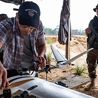 Jorge Caballero Espejo, Drone and GIS Coordinator at CINCIA, preparing CINCIA's fixed-wing drone. Following Peru's February 2019 militarized crackdown on illegal and unofficial alluvial gold mining in the La Pampa region of Madre de Dios, Wake Forest University's Puerto Maldonado-based Centro de Innovación Científica Amazonia (CINCIA), a leading research institution for the development of technological innovation for biological conservation and environmental restoration in the Peruvian Amazon, is applying years of scientific research and technical experience related to understanding mercury contamination and managing Amazonian ecosystems. What they learn will help guide urgent remediation, restoration, and reforestation efforts that can also serve as models for how we address the tropic's most dramatically devastated landscapes around the world. La Pampa, Madre de Dios, Peru.