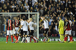 Both sets of teams argue with the referee - Photo mandatory by-line: Dougie Allward/JMP - Mobile: 07966 386802 - 30/09/2014 - SPORT - Football - Derby - Pride Park - Derby County v AFC Bournemouth - Sky Bet Championship