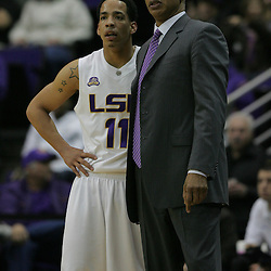 Jan 04, 2010; Baton Rouge, LA, USA;  LSU Tigers head coach Trent Johnson stands with Bo Spencer (11) during the second half against the McNeese State Cowboys at the Pete Maravich Assembly Center. LSU defeated McNeese State 83-60.  Mandatory Credit: Derick E. Hingle-US PRESSWIRE