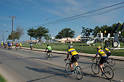 Riders pass by the Fort Worth Aviation Museum during in the first day of the 2014 Tour de Fort Worth, an annual event hosted by Mayor Betsy Price to promote cycling within the city while also giving her a chance to connect with her constituents on July 5, 2014 in Fort Worth, Texas. (Cooper Neill for The New York Times)