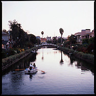 "People enjoy evening rowing as dusk falls on the Venice Canals in Los Angeles, California.  ""Venice of America"" was founded by tobacco millionaire Abbot Kinney in 1905 and was modeled after those in Italy."