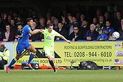 AFC Wimbledon defender Toby Sibbick (35) and Peterborough United striker Tom Nichols (21) during the EFL Sky Bet League 1 match between AFC Wimbledon and Peterborough United at the Cherry Red Records Stadium, Kingston, England on 17 April 2017. Photo by Stuart Butcher.