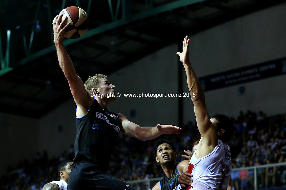 Rhys Carter of the Breakers drives to the hoop. 2014/15 ANBL, SkyCity Breakers vs Wollongong Hawks, North Shore Events Centre, Auckland, New Zealand. Thursday 8 January 2015. Photo: Anthony Au-Yeung / www.photosport.co.nz