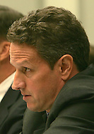 Timothy Geithner, president, Federal Reserve Bank of New York listens to  Chairman Barney Frank during a hearing of the Financial Services Committee of the House of Representatives in Washington, DC on July 24, 2008.  Photograph: Dennis Brack