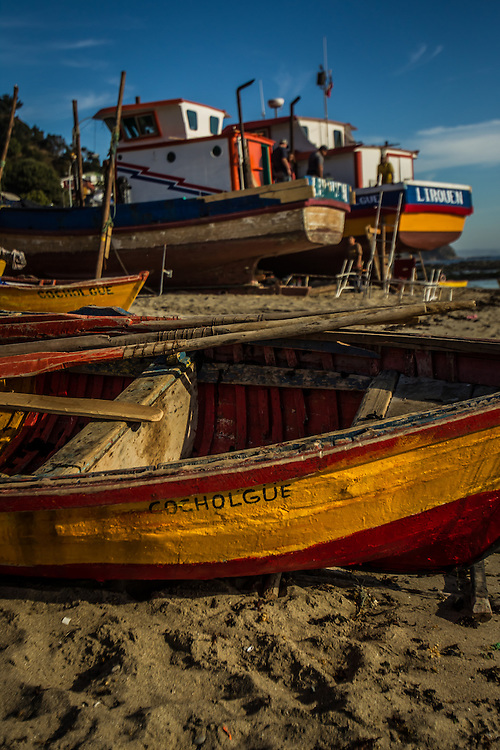 COCHOLGUE, CHILE - MARCH 19, 2014:   Artisanal fishing boats on the beach in Cocholgue, a small fishing village near Concepcion, Chile. PHOTO: Meridith Kohut for The World Wildlife Fund