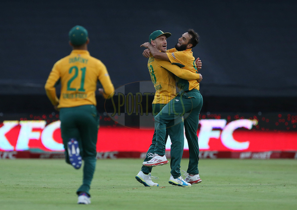 Far du Plussis hugs Imran Tahir during the First KFC T20 Match between South Africa and England played at Newlands Stadium, Cape Town, South Africa on February 19th 2016