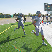 Detroit's Cody High Varsity football team takes the field for the first time on its new turf.