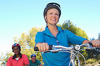 Three seniors riding bicycles