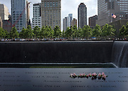 © Licensed to London News Pictures. 25/05/2012. New York, USA. Flowers lie on the memorial at the 9/11 site in New York City today 25th May 2012. On may 30th 2012, the 9/11 Memorial will welcome the men and women who participated in the 9/11 recovery at The World Trade Centre. The day will mark the 10 year anniversary of the official end of the recovery.  Photo credit : Stephen Simpson/LNP