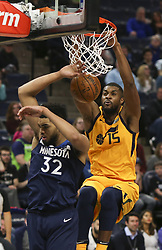 April 1, 2018 - Minneapolis, MN, USA - Utah Jazz forward Derrick Favors (15) dunks on Minnesota Timberwolves center Karl-Anthony Towns (32) in the second half on Sunday, April 1, 2018 at Target Center in Minneapolis, Minn. Favors finished with 16 points. (Credit Image: © Jeff Wheeler/TNS via ZUMA Wire)