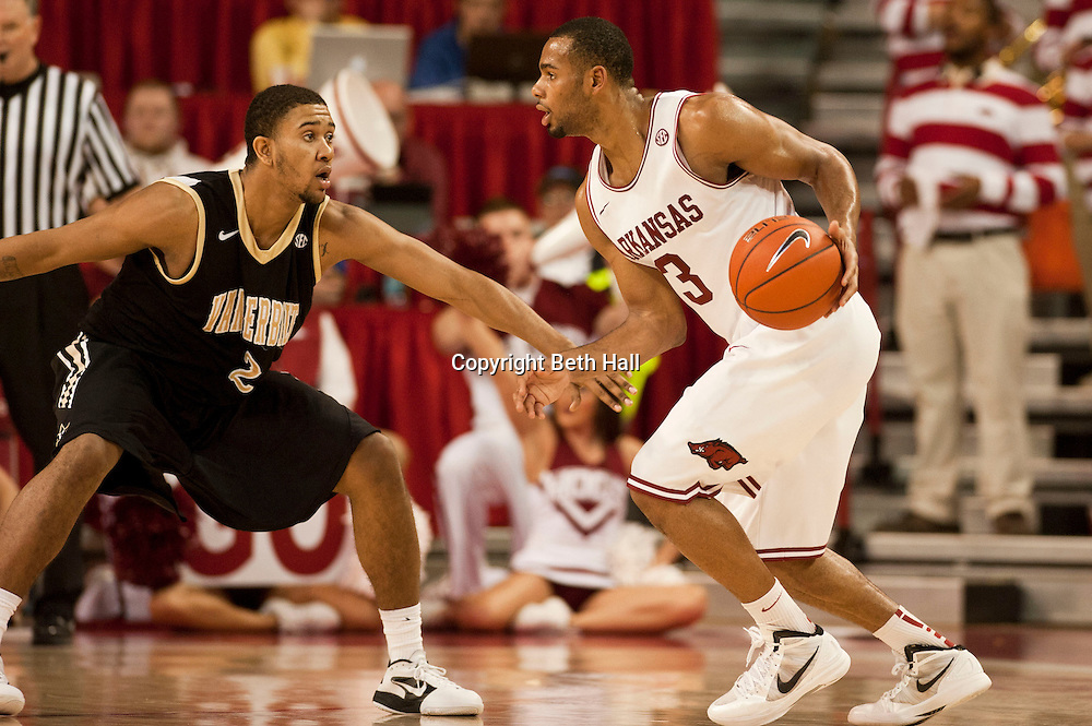 Jan 29, 2012; Fayetteville, AR, USA; Arkansas Razorbacks guard Rickey Scott (3) dribbles the ball against Vanderbilt Commodores guard Kedren Johnson (2) during a game at Bud Walton Arena. Arkansas defeated Vanderbilt 82-74. Mandatory Credit: Beth Hall-US PRESSWIRE