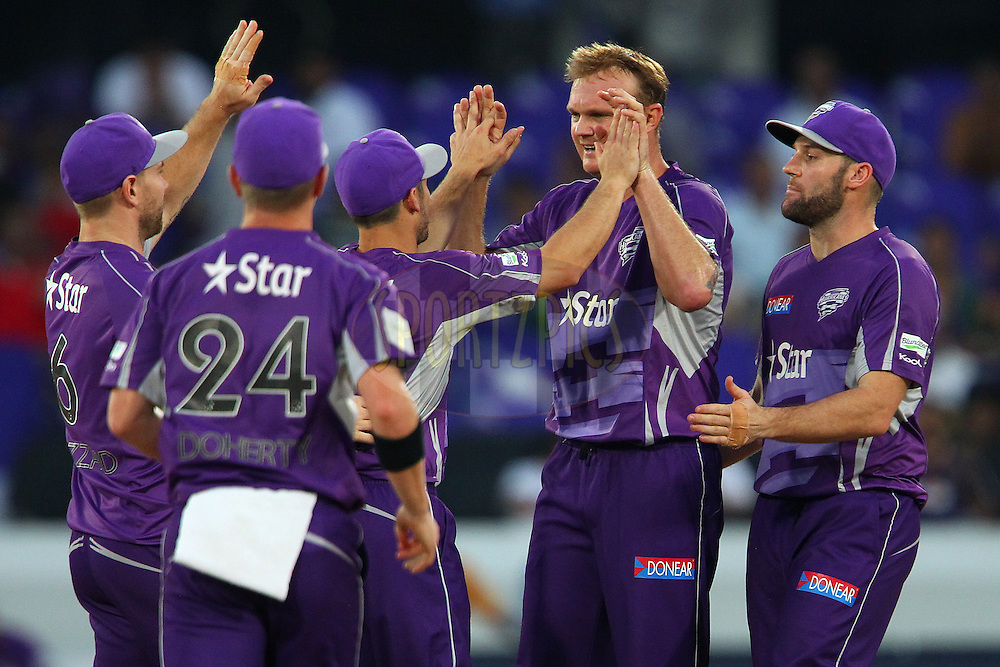 Doug BOLLINGER of the Hobart Hurricanes celebrates the wicket of Gautam GAMBHIR (Captain) of the Kolkata Knight Riders  during the first semi final match of the Oppo Champions League Twenty20 between the Kolkata Knight Riders and the Hobart Hurricanes held at the Rajiv Gandhi Cricket Stadium, Hyderabad, India on the 2nd October 2014<br /> <br /> Photo by:  Ron Gaunt / Sportzpics/ CLT20<br /> <br /> <br /> Image use is subject to the terms and conditions as laid out by the BCCI/ CLT20.  The terms and conditions can be downloaded here:<br /> <br /> http://sportzpics.photoshelter.com/gallery/CLT20-Image-Terms-and-Conditions-2014/G0000IfNJn535VPU/C0000QhhKadWcjYs
