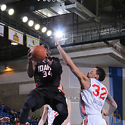 Idaho Stampede Guard Jermaine Taylor (34) drives towards the basket as Delaware 87ers Forward Drew Gordon (32) defends in the first half of a NBA D-league regular season basketball game between the Delaware 87ers and the Idaho Stampede (Utah Jazz) Tuesday, Feb. 03, 2015 at The Bob Carpenter Sports Convocation Center in Newark, DEL