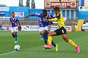 Kevin Osei runs past Josh Passley during the Sky Bet League 2 match between Carlisle United and Dagenham and Redbridge at Brunton Park, Carlisle, England on 12 September 2015. Photo by Craig McAllister.
