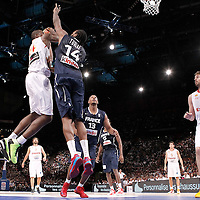 15 July 2012: Serge Ibaka of Team France goes for the layup against Ronny Turiaf during a pre-Olympic exhibition game won 75-70 by Spain over France, at the Palais Omnisports de Paris Bercy, in Paris, France.